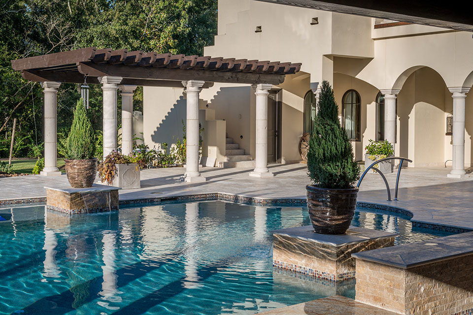 Custom exterior with pool and columns