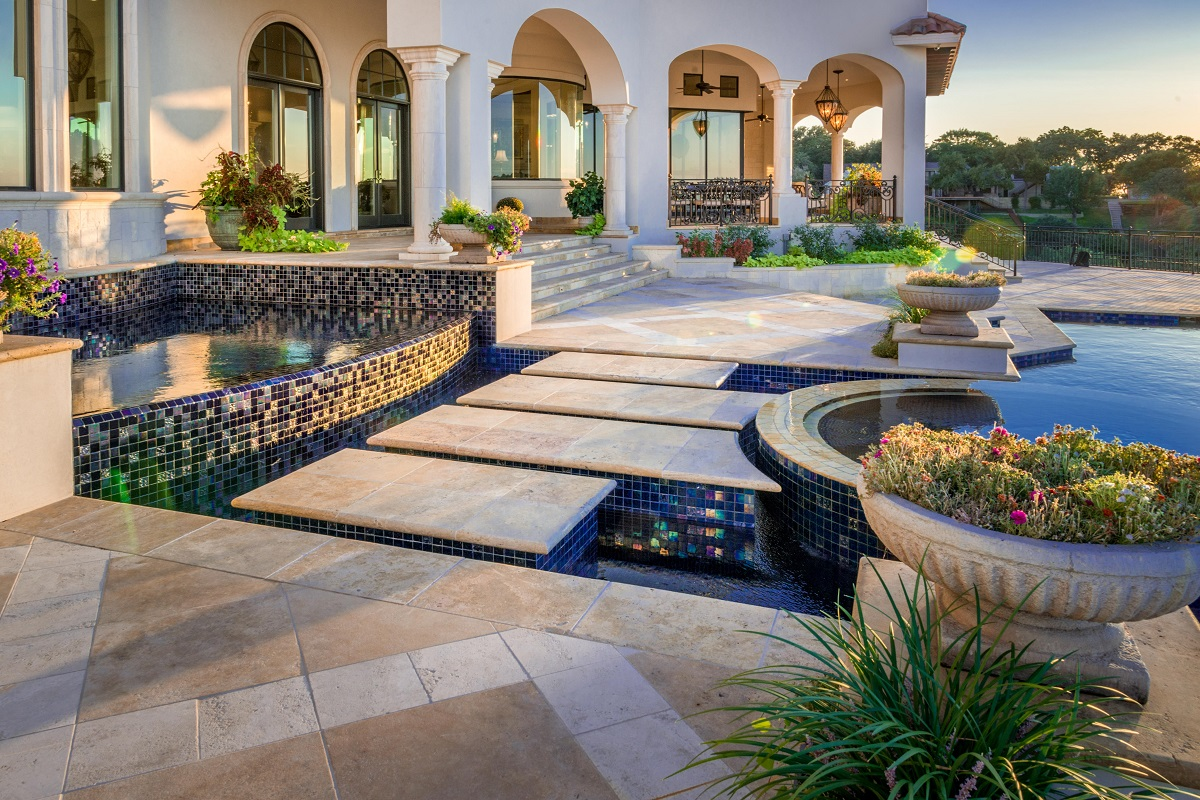 Exterior of a luxury home with pool and interesting tiling